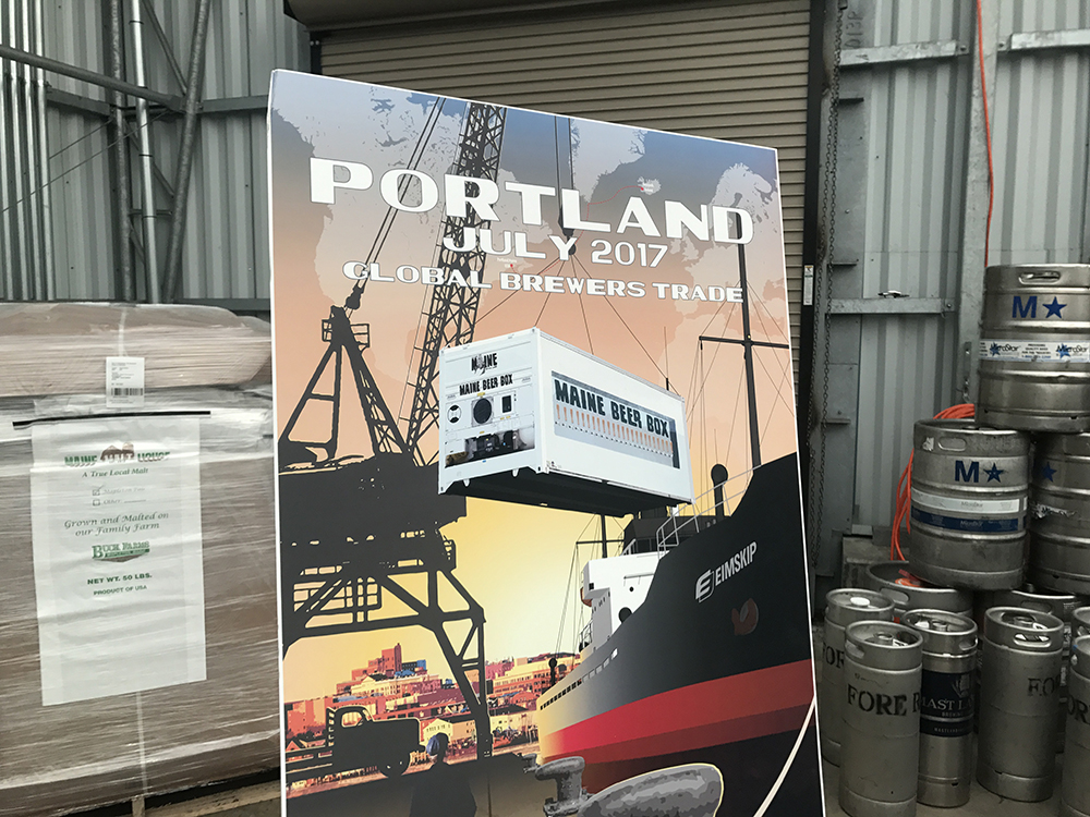 """A poster on display Thursday at  Eimskip's container facility on the Portland waterfront shows an artist's conception of the """"Maine Beer Box"""" that will be shipped to Iceland for a June festival."""