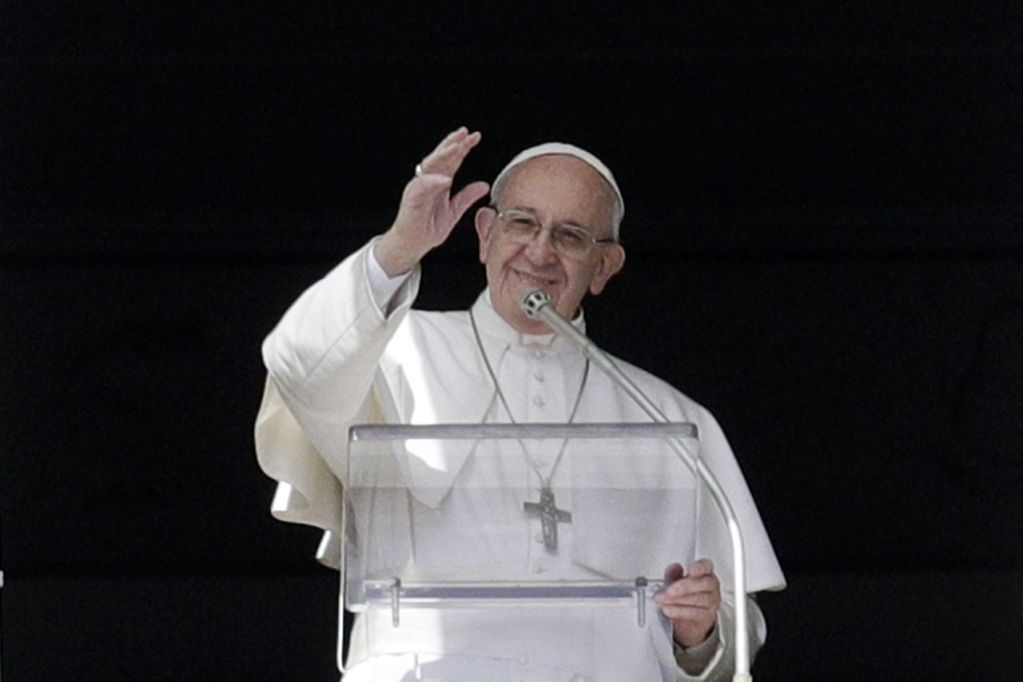 Pope Francis waves to faithful after delivering the Angelus prayer  in St. Peter's Square at the Vatican on Sunday.