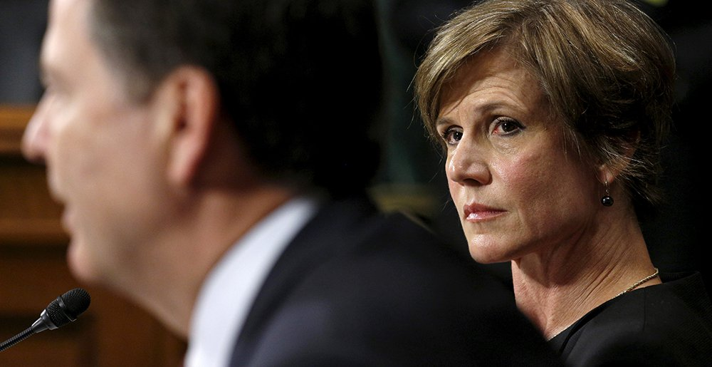 Deputy Attorney General Sally Yates listens as FBI Director James Comey speaks during a Senate Judiciary Committee hearing in 2015.  In January, Yates warned White House Counsel Don McGahn that statements made by White House officials about Michael Flynn's contacts with the Russian ambassador were incorrect, and could therefore expose the national security adviser to future blackmail by the Russians.