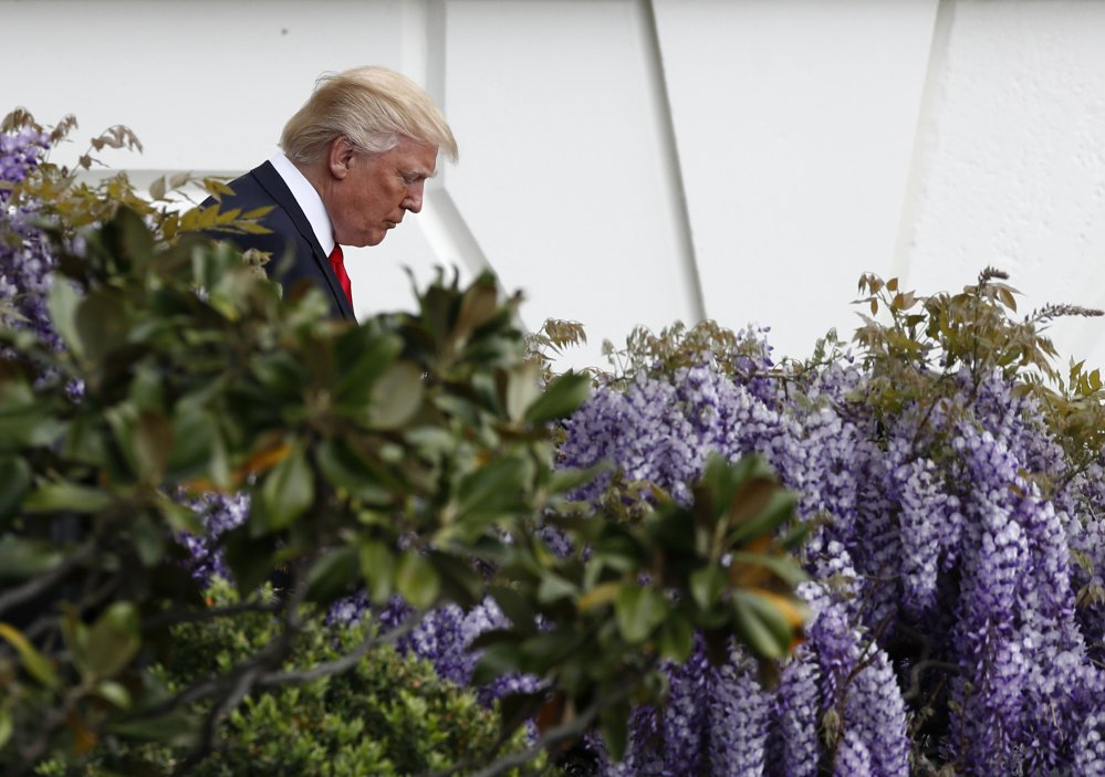 President Trump walks down the stairs from the Truman Balcony to the South Lawn during the annual White House Easter Egg Roll in Washington on Monday.