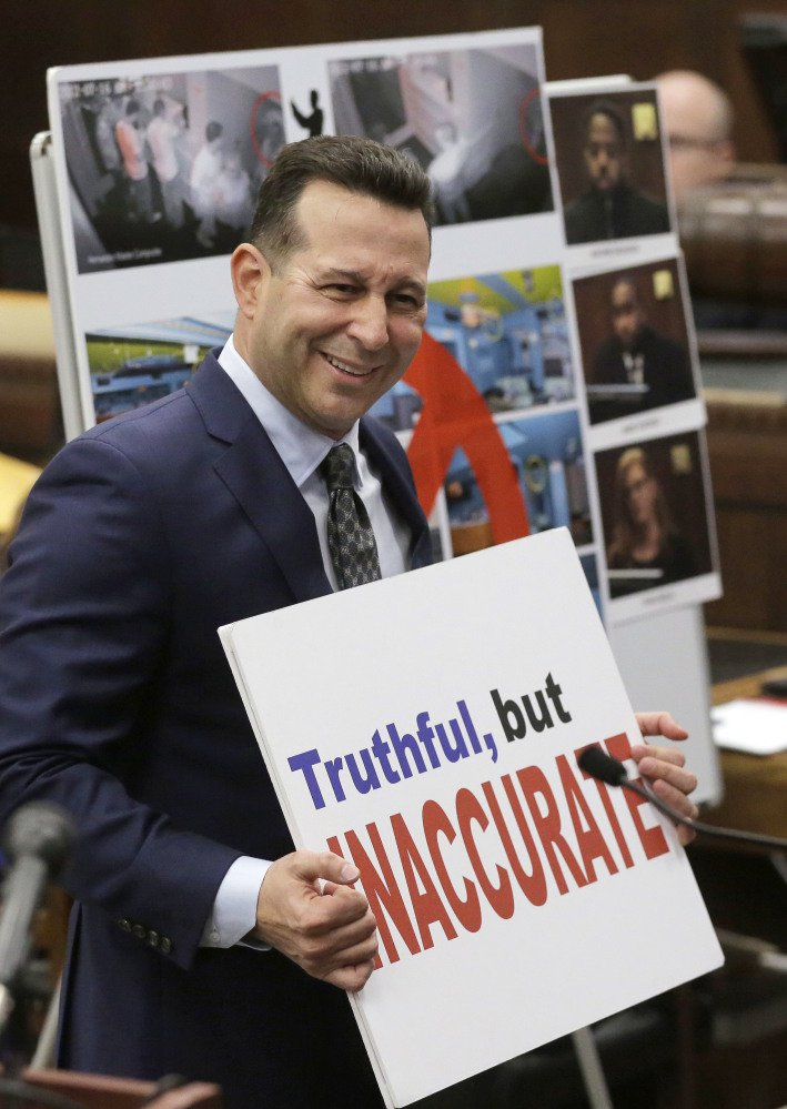 Defense attorney Jose Baez holds a placard while presenting closing arguments in the trial of former New England Patriots tight end Aaron Hernandez in Boston. Baez won an acquittal for Hernandez in the double-murder case, and for Casey Anthony in 2011 in the death of her toddler.