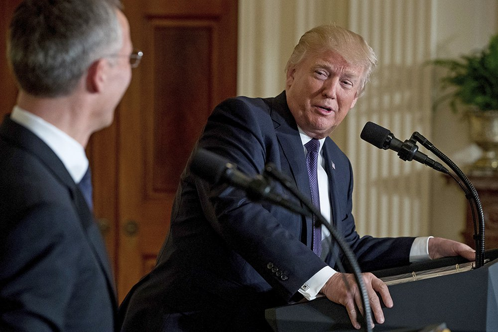 President Trump, accompanied by NATO Secretary General Jens Stoltenberg, speaks at a news conference at the White House Wednesday.