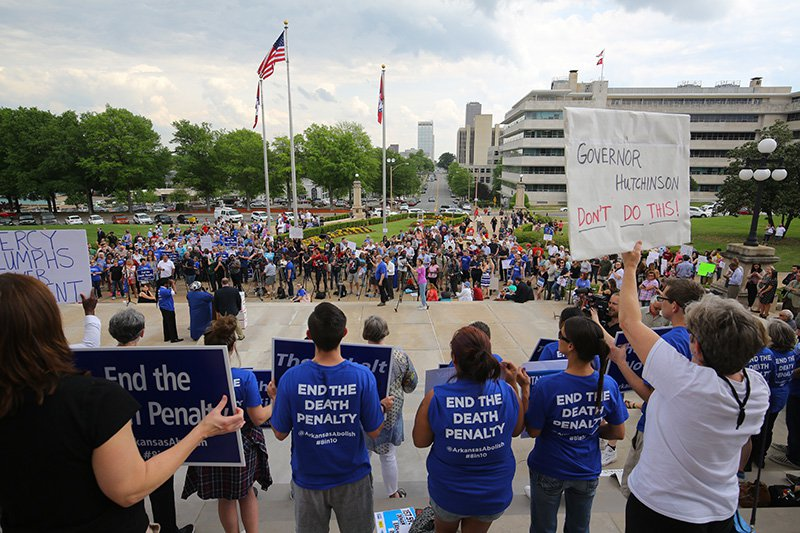 People gather at a rally opposing the state's upcoming executions, on the front steps of Arkansas' Capitol on Friday.