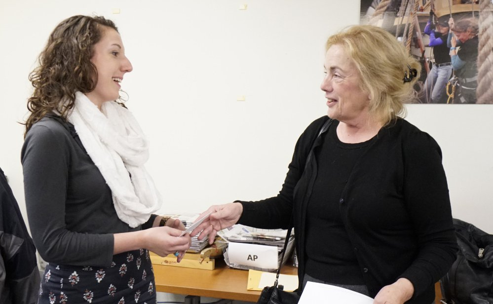 Metro reporter Megan Doyle receives a check from Mary McCann Fiske at the Press Herald office as part of the MacGregor Fiske Award given to a top young journalist each year. Doyle is the first award recipient from Maine.
