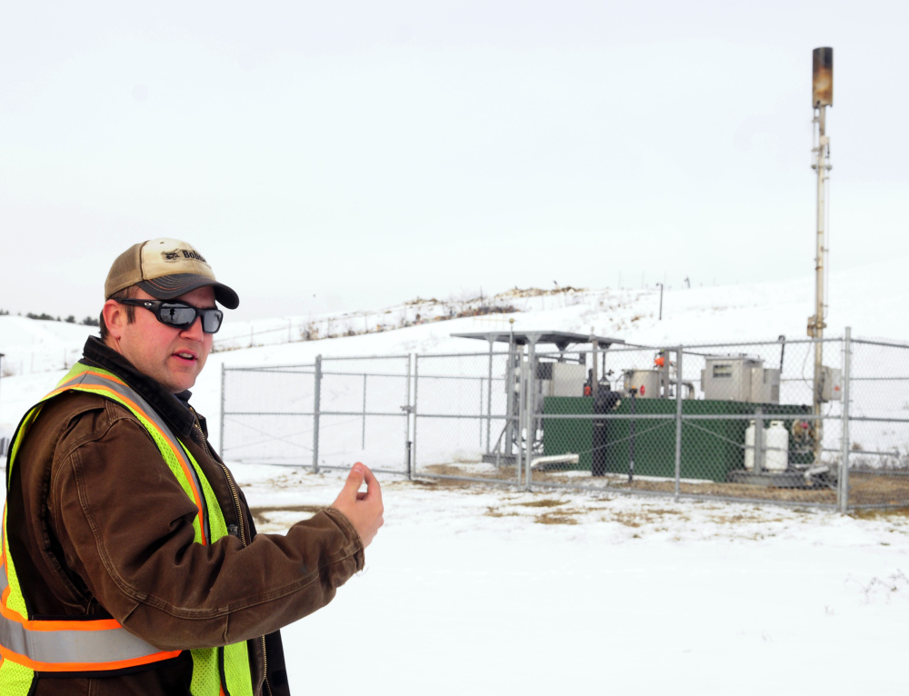 Lane Gould, technical supervisor at Hatch Hill, talks about the methane flare on Jan. 10 at the landfill in Augusta.