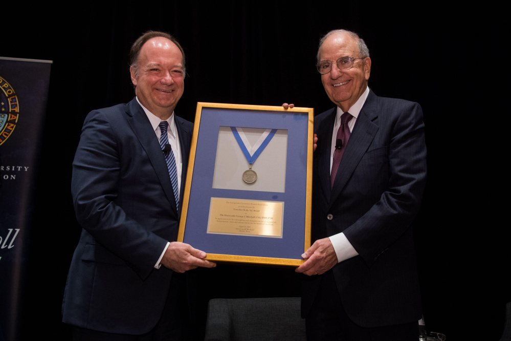 Georgetown University President John J. DeGioia, left, presents a special Timothy S. Healy, S.J. Award to former U.S. Sen. George J. Mitchell Jr., D-Maine, or his exemplary public service in support of society and humanitarian causes.