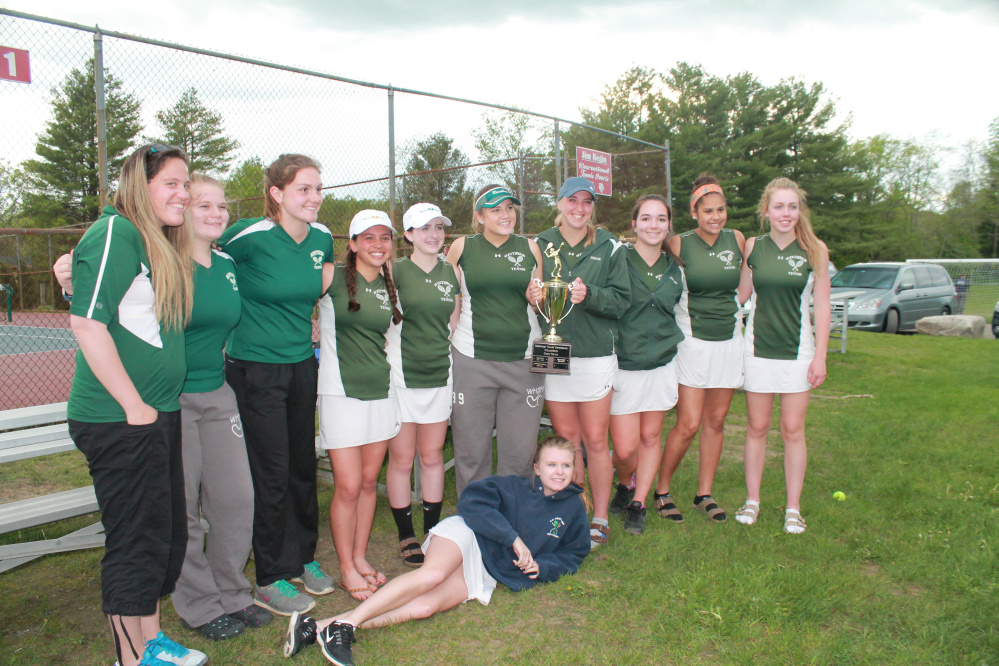 The Winthrop girls tennis team celebrates after winning the Mountain Valley Conference championship over Carrabec in Waterville on Wednesday.