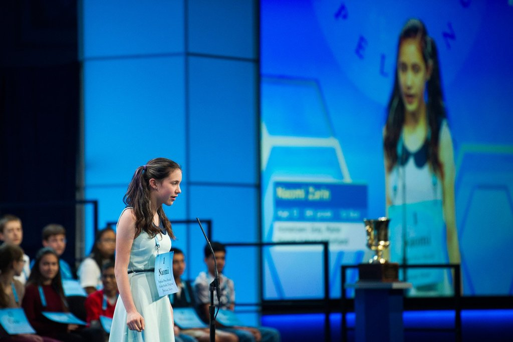 Naomi Zarin, 12, of Gray, Maine, correctly spells her word during the 90th Scripps National Spelling Bee in Oxon Hill, Maryland, on Wednesday.