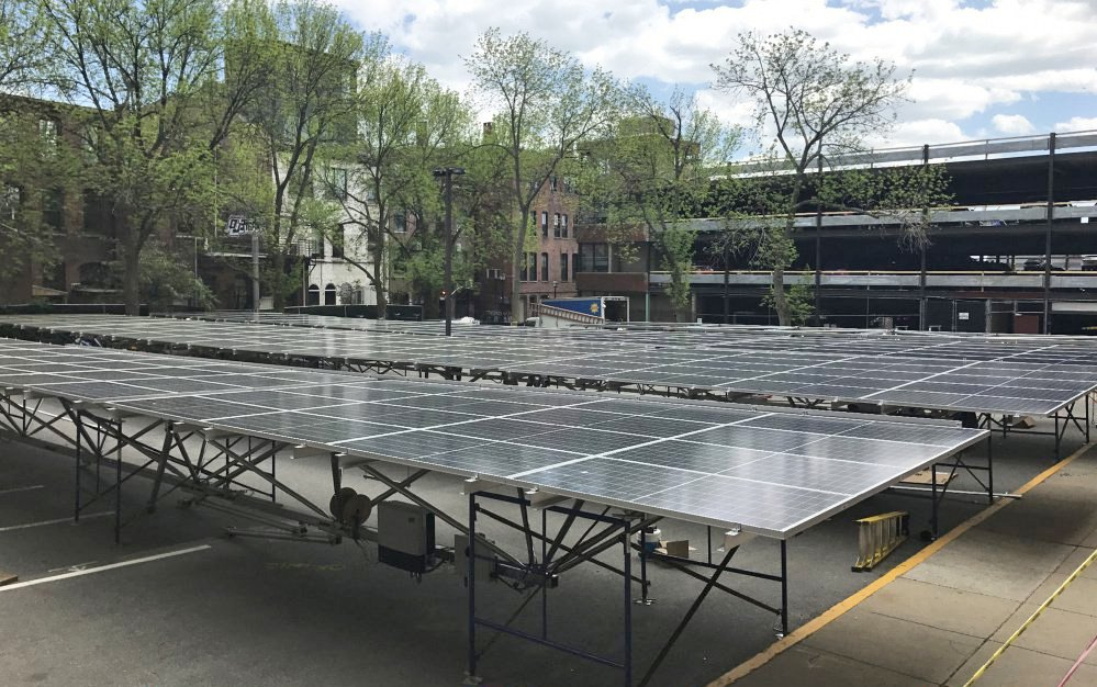 A solar array sits in a parking lot next to the Fore Street parking garage where it was later installed.