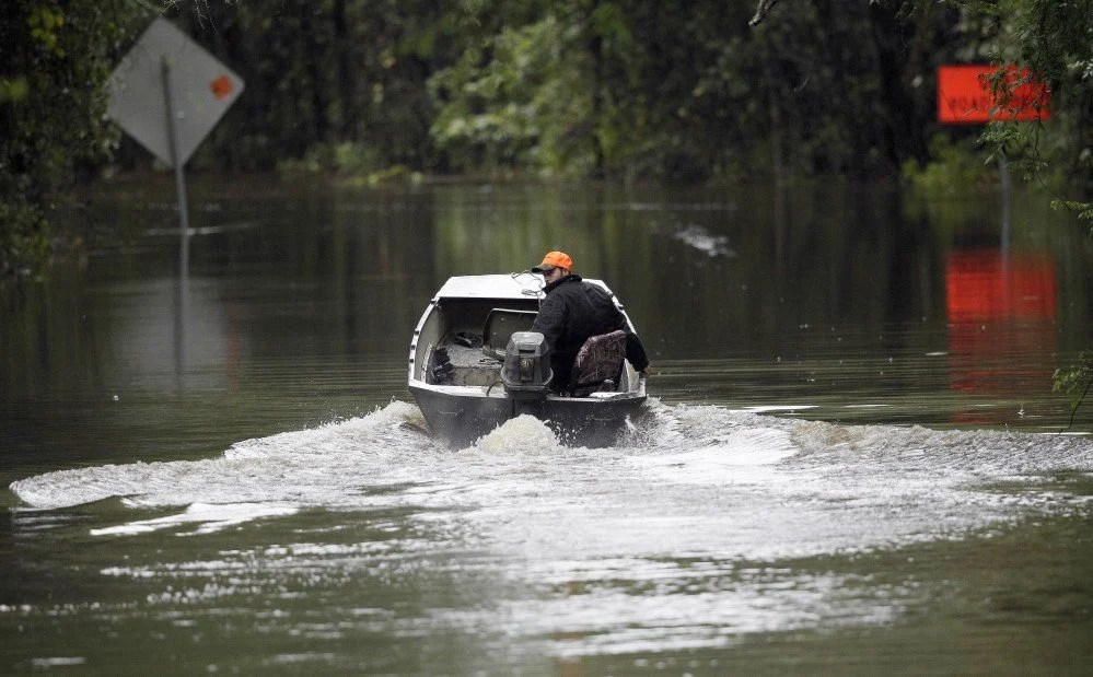 A South Carolina man uses his boat on a flooded East Black Creek Road to his home following heavy rains in Florence, S.C. Meteorologists are now as good with their five-day forecasts as they were with their three-day forecasts in 2005, according to ForecastWatch, a private firm that rates accuracy of weather forecasts.