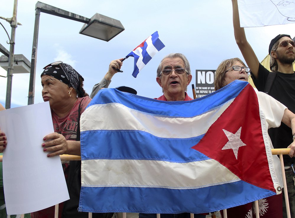 Nelson Avila, center, joins anti-President Trump protesters calling for open relations with Cuba on Friday in Miami.