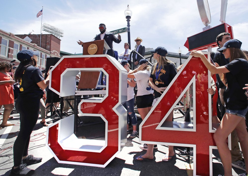 Retired Boston Red Sox designated hitter David Ortiz addresses a gathering, where part of Yawkey Way was renamed David Ortiz Drive, on Thursday outside Fenway Park in Boston.