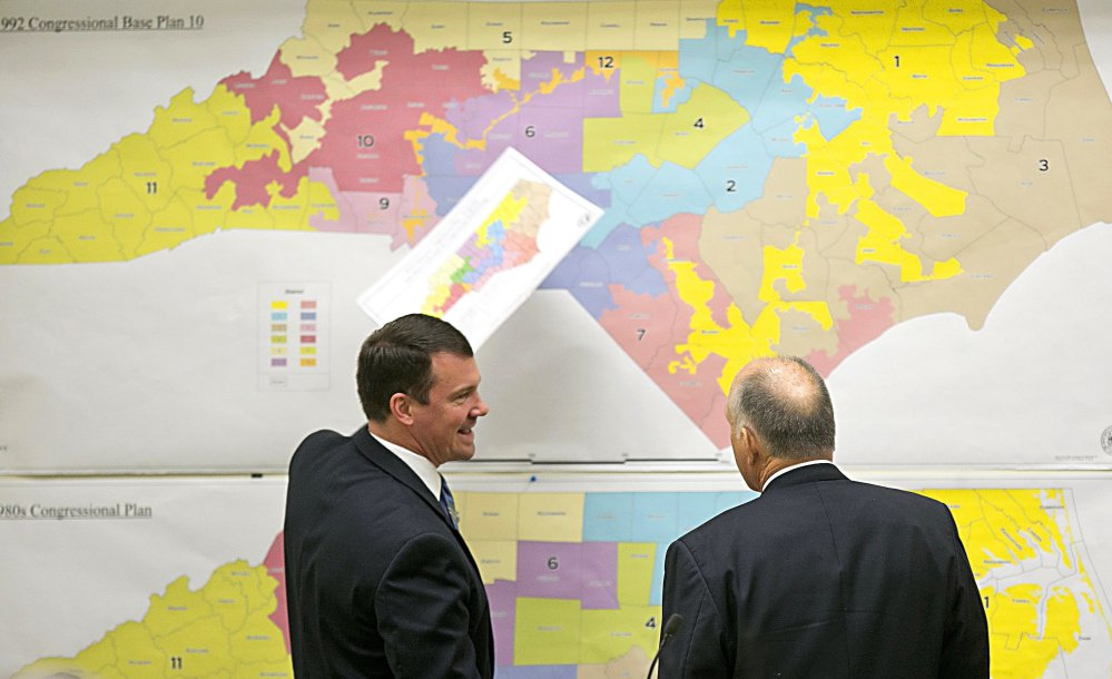 North Carolina Republican state Sens. Dan Soucek, left, and Brent Jackson review historical maps during The Senate Redistricting Committee for the 2016 Extra Session in the Legislative Office Building in Raleigh, N.C., last year.