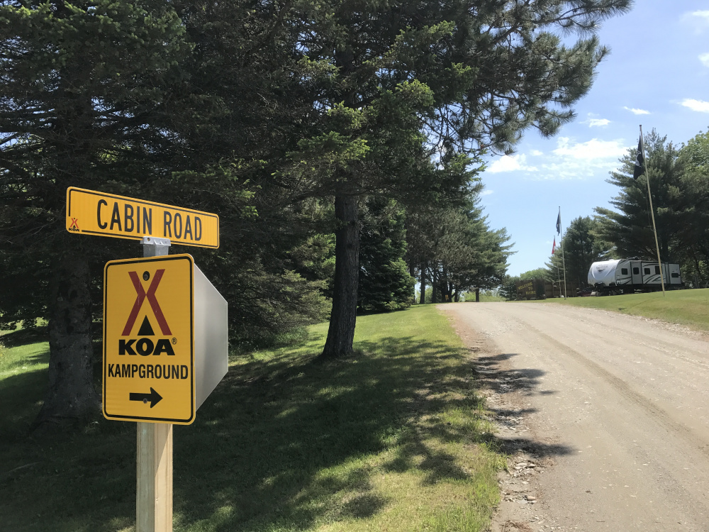 The road leading to the campground where the owners say campers escalated an incident with a man with special needs who was slashing tires with a pocket knife.