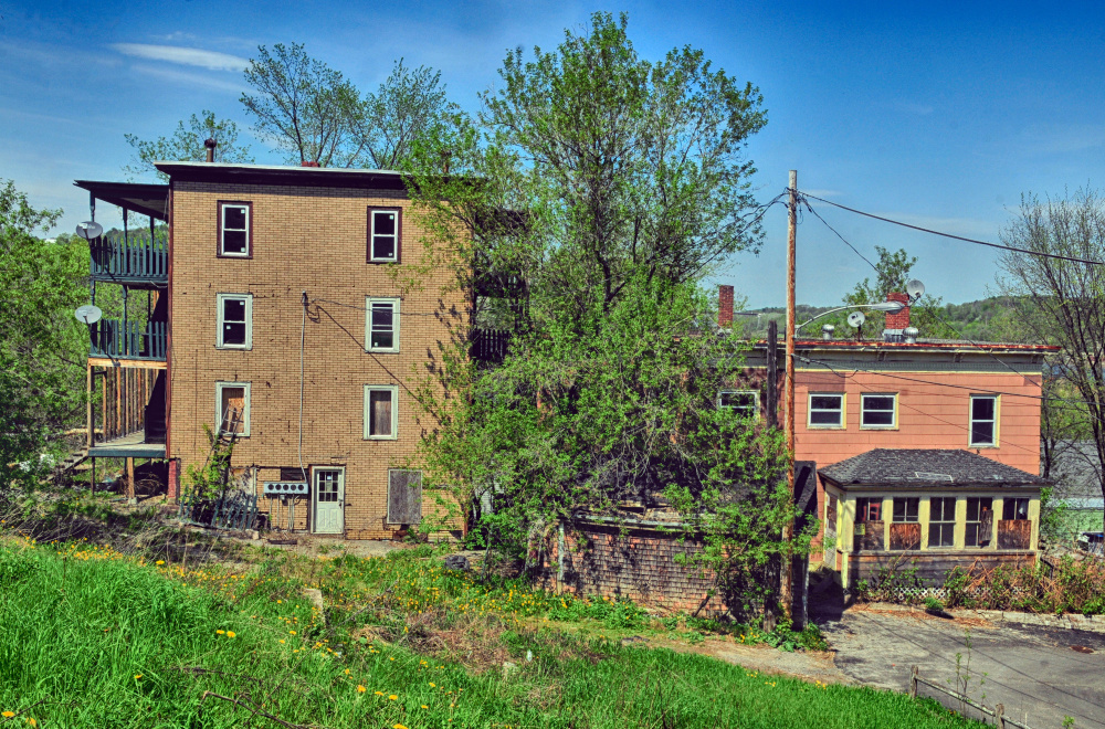 Properties at 11 State St., left, and 15 Morton Place in Augusta are seen last month.