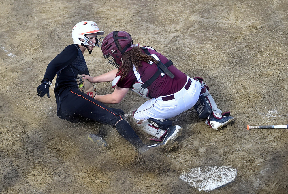 Edward Little catcher Emma Lashua tags out Skowhegan runner Emma Duffy during the Kennebec Valley Athletic Conference Class A title game Friday.