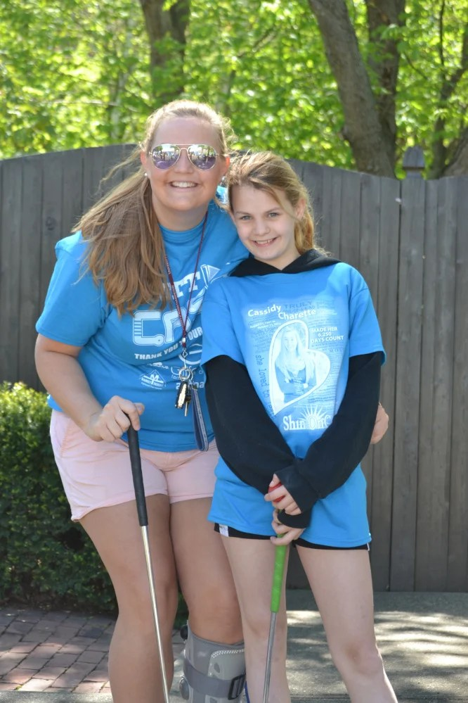 """""""Big Sister"""" Anna Dobos and her """"Little Sister"""" Delaney Bickford were among the 250 people who attended Big Brothers Big Sisters of Mid-Maine's first """"Putt 4 Cass"""" event May 20 at Gifford's Famous Ice Cream and Mini Golf in Waterville. The event, held in memory and honor of Cassidy Charette, raised more than $25,000 to support local BBBS school-based mentoring programs."""