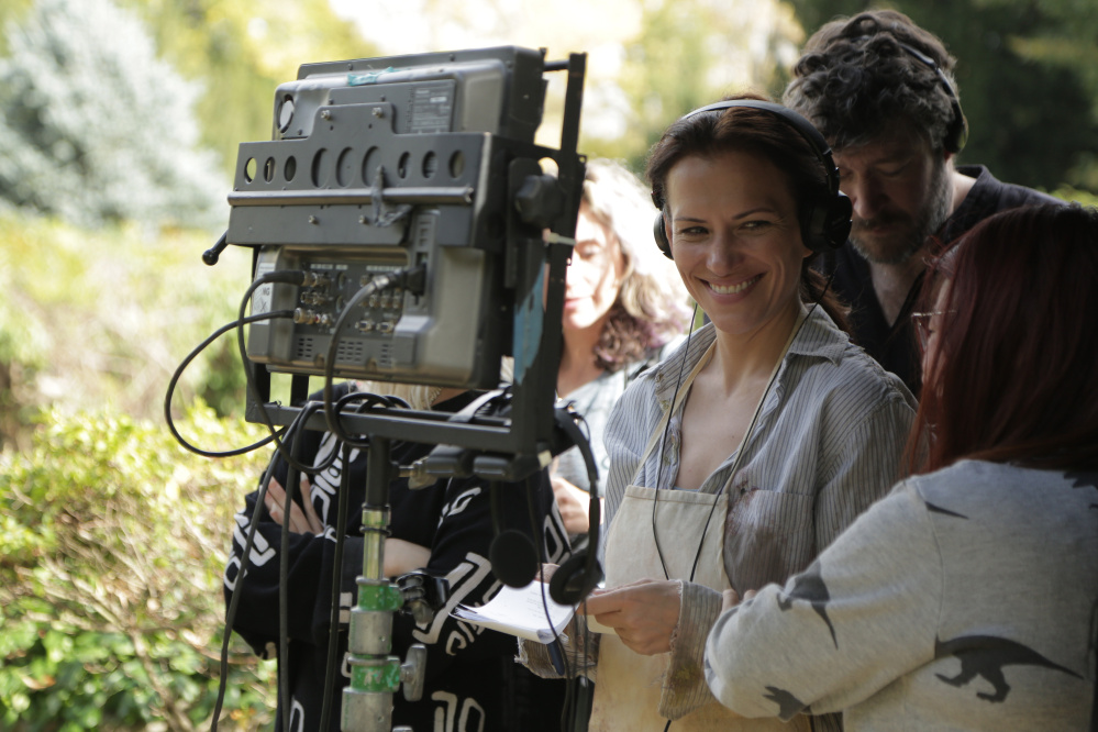 """""""The Sounding"""" will open the 20th annual Maine International Film Festival this year. Catherine Eaton, in headphones, directed the film she wrote and played the lead role of Liv. Producer and co-writer Bryan Delaney stands behind her."""
