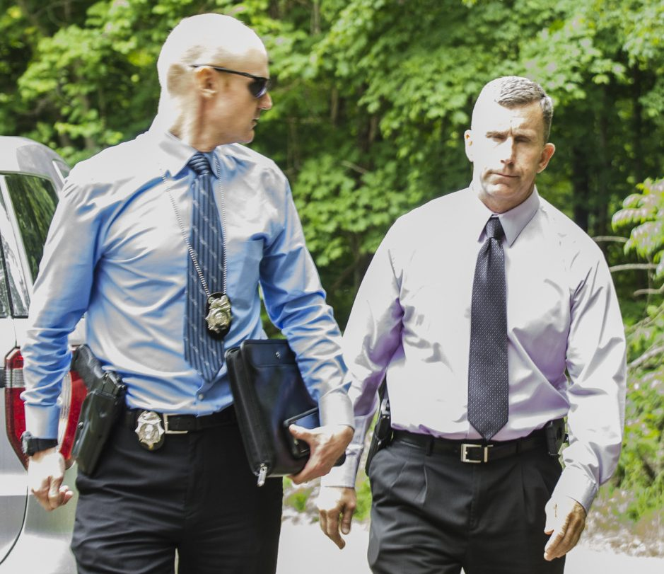 Detective Benjamin Sweeney, left, and Sgt. Christopher Tremblay, both of the Maine State Police, confer on Saturday at the scene of a fatal shooting off Yeaton Drive in West Gardiner, The victim, James Haskell, 41, was a visitor at the property, according to Steve McCausland, spokesman for the Maine Department of Public Safety.