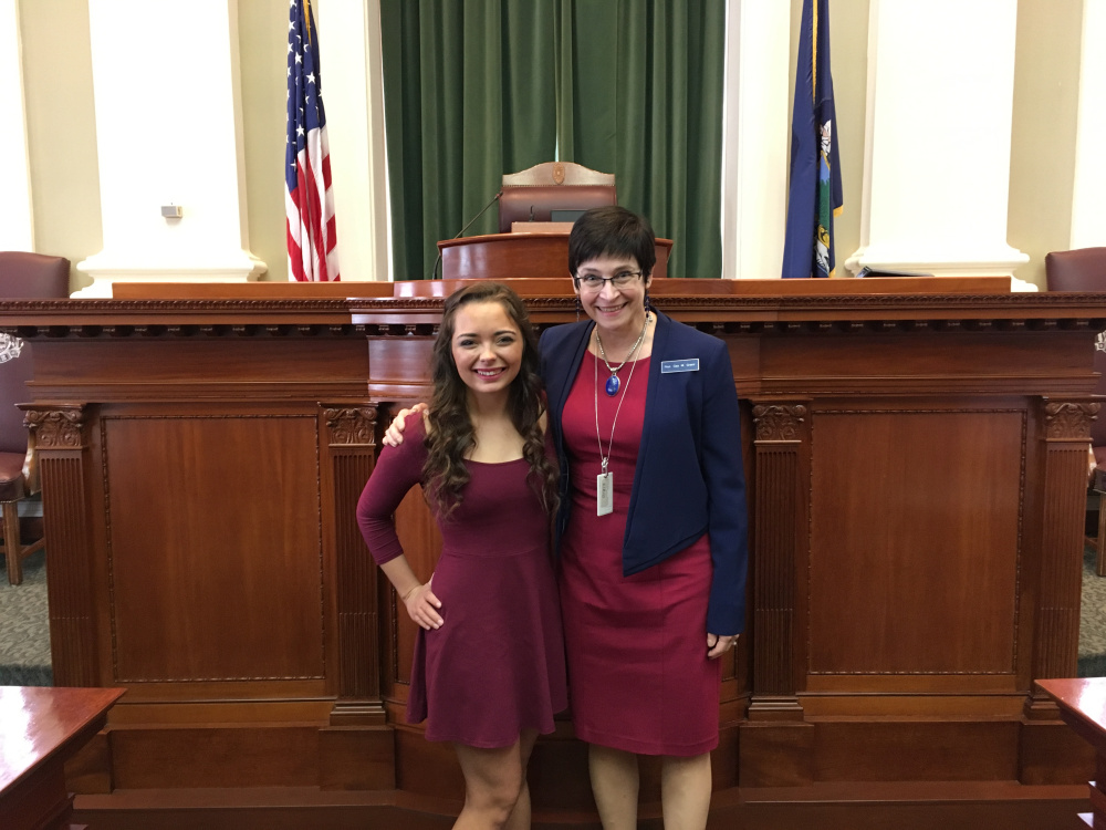 Kristen Pooler, 20, of Gardiner, left, sang the national anthem June 6 on the floor of the Maine House of Representatives during the opening ceremonies. She was welcomed to the State House by Rep. Gay Grant, D-Gardiner.