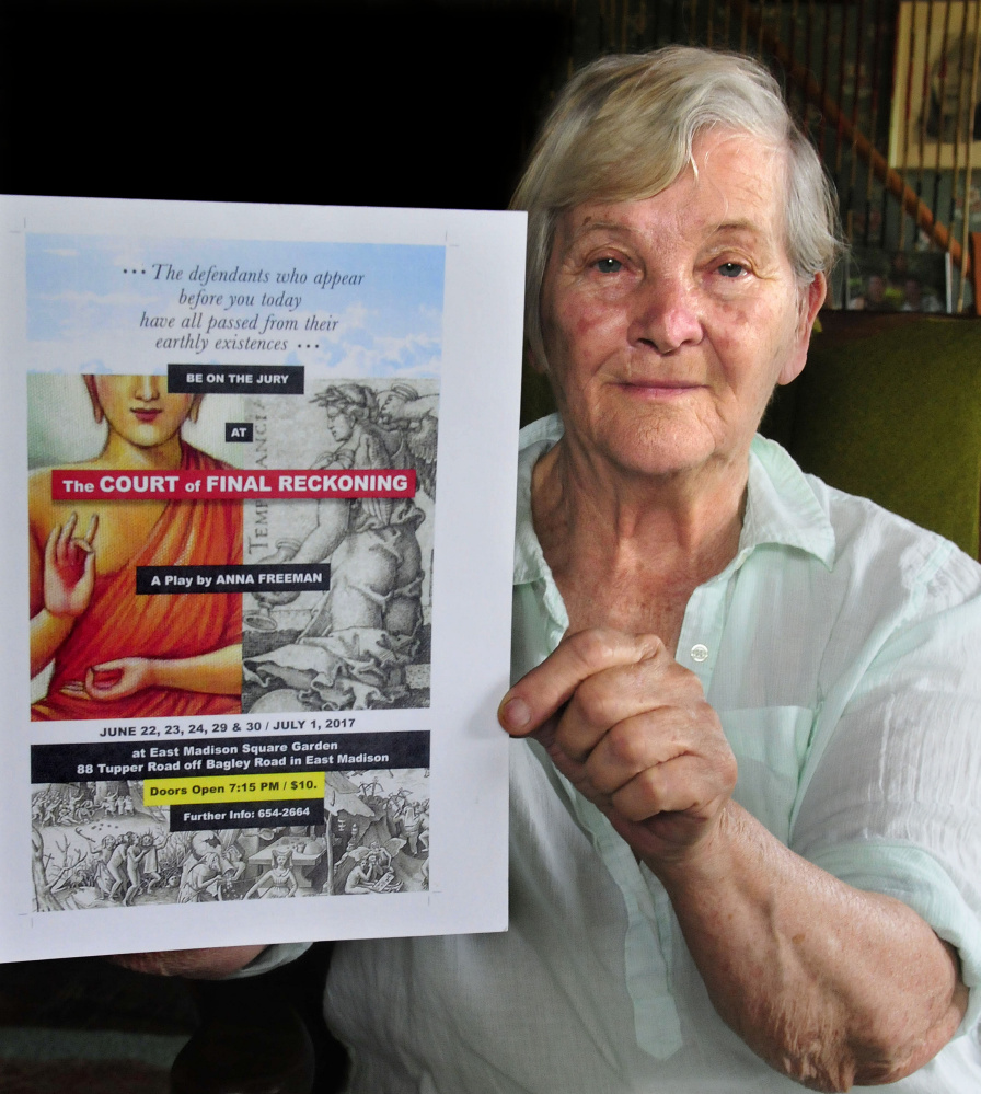 """Anna Freeman holds a poster for her play """"The Court of Final Reckoning"""" that she wrote and will direct at the East Madison Square Garden on June 22-24 and June 29-July 1."""