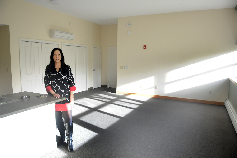 Augusta Housing Authority Director Amanda Bartlett stands in an apartment for rent Nov. 10, 2016, at the former Hodgkins Middle School in Augusta. The agency plans to host an open house for the public Thursday at the former school.