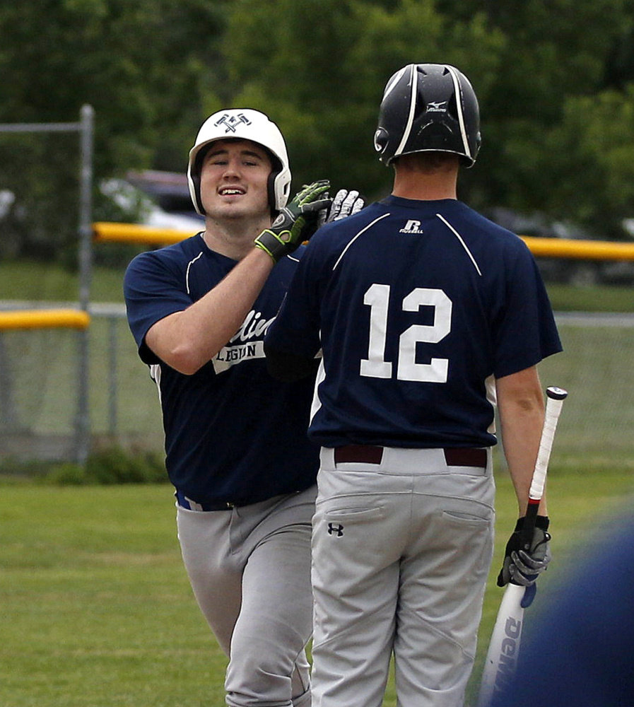 Gardiner's Ryan Kappelmann is congratulated at home plate after hitting a home run against Augusta in the first inning of an American Legion baseball game Thursday in Augusta.