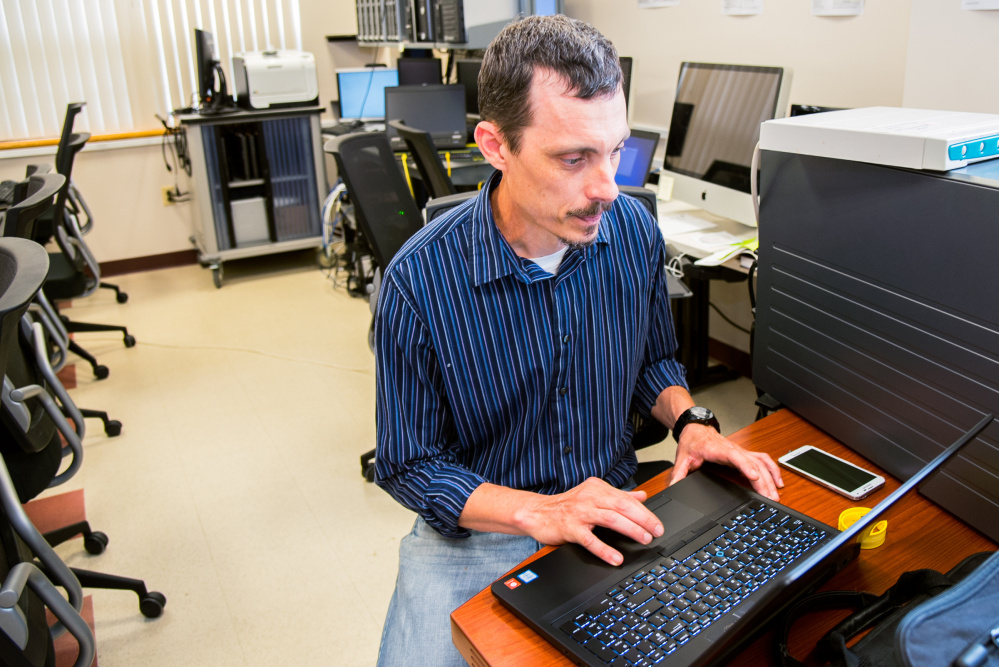 Robert Thompson, a University of Maine at Augusta student, works on a project Friday in the cybersecurity laboratory on campus in Augusta.