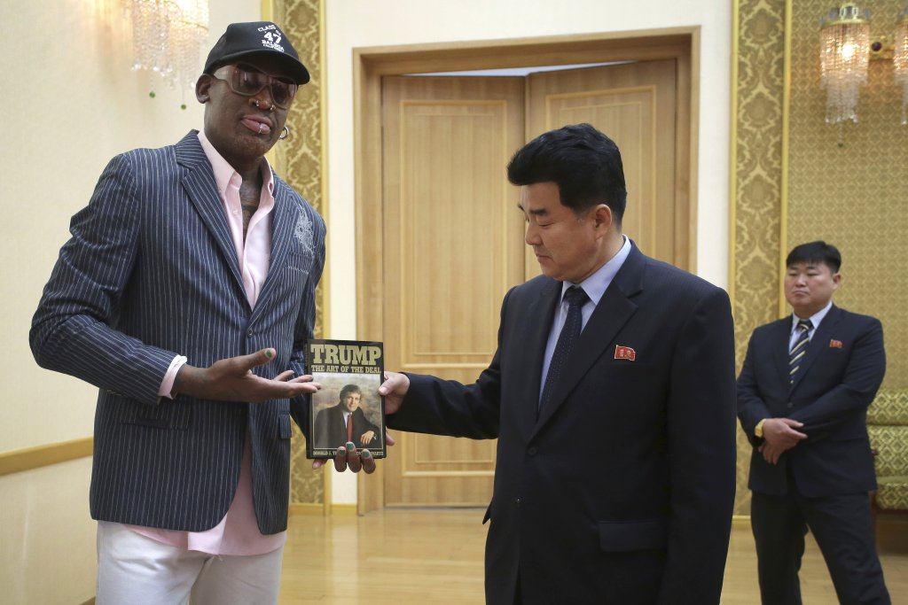 "Former NBA star Dennis Rodman presents Donald Trump's book ""The Art of the Deal"" to North Korean Sports Minister Kim Il Guk on Thursday in Pyongyang, North Korea."