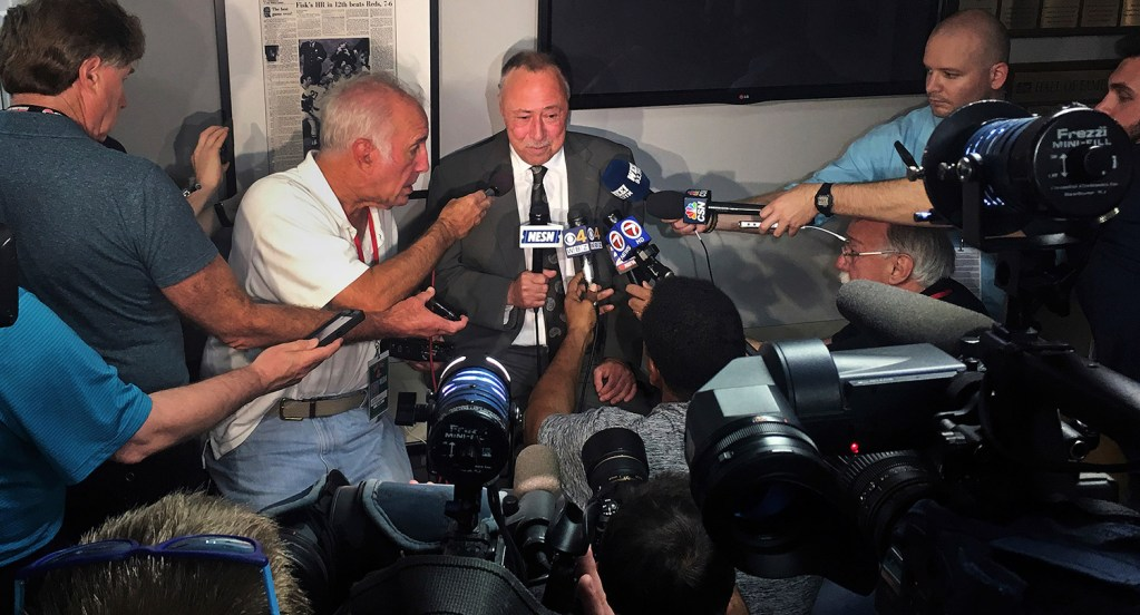 Boston Red Sox broadcaster Jerry Remy is surrounded by reporters as he announces that he has been diagnosed with cancer, prior to a baseball game at Fenway Park in Boston on Monday. Remy said he has been diagnosed with lung cancer for the fifth time and will have surgery to treat it in two weeks.