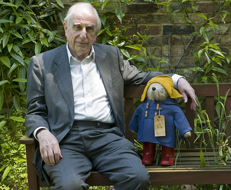British author Michael Bond sits with a Paddington Bear toy during an interview in 2008.