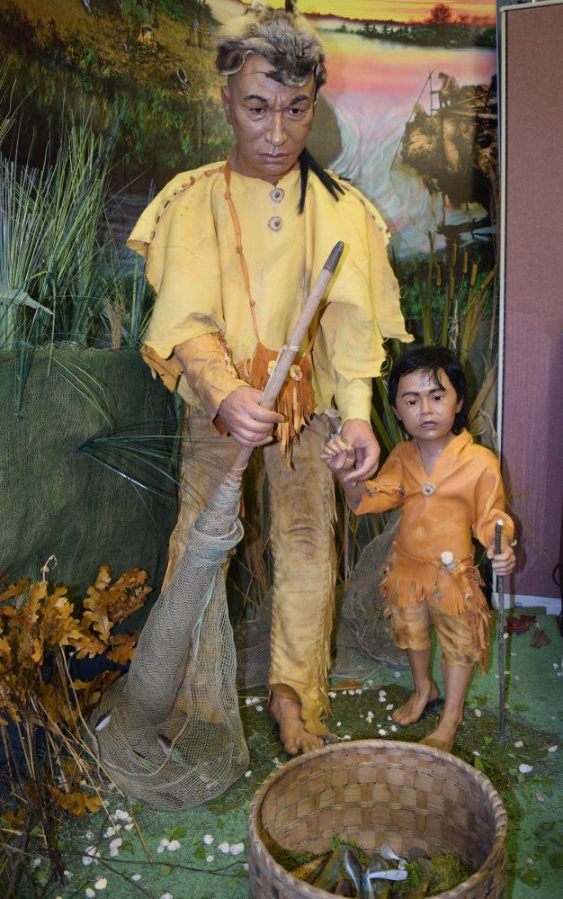 """Mannequins as part of the """"Remembered Vision"""" exhibit at the Vassalboro Historical Society depict a native fisherman and his son on the Cates Farm site in Vassalboro."""