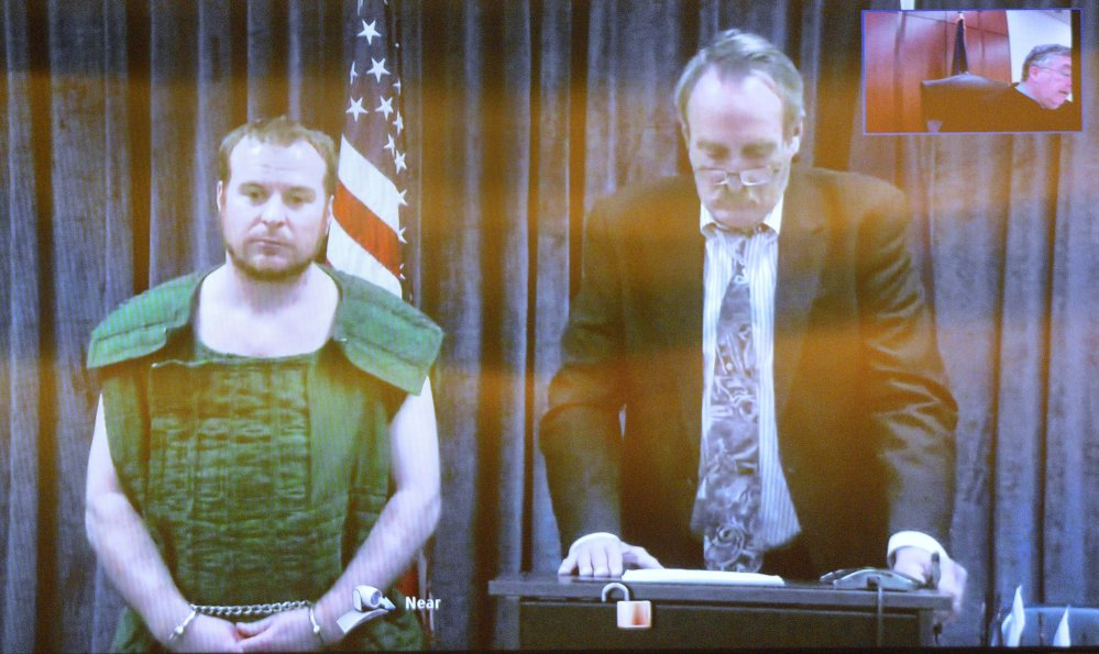 Jeremy Clement, left, and his attorney, Steve Bourget, appear on video from the Kennebec County jail during his initial appearance April 21 at the Capital Judicial Center in Augusta.