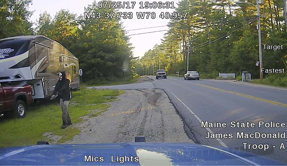 Dashboard camera image released by Maine State Police shows a man later identified as Corey Berry walking along Plains Road in Hollis.