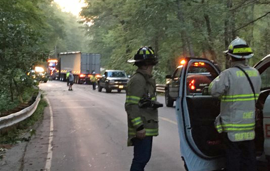 Firefighters on the scene of a tanker truck crash in Fryeburg Tuesday morning.