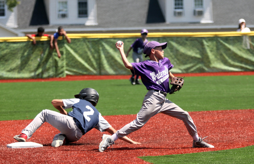 Waterville second baseman Jon Roach tries to turn a double play as Barrington, New Hampshire baserunner Jon Pelletier, left, slides into second base during a Cal Ripken 11U New England regional quarterfinal game Tuesday at Purnell Wrigley Field in Waterville. Waterville won 8-1.