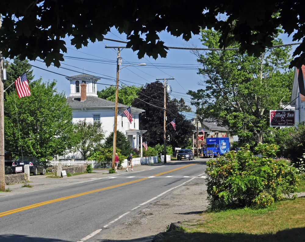 "Route 27 in Belgrade Lakes village is seen in August 2016. Select board members voted Tuesday to resume consideration of a proposed ""Traffic Control and Parking Ordinance"" that mainly would affect the village area."