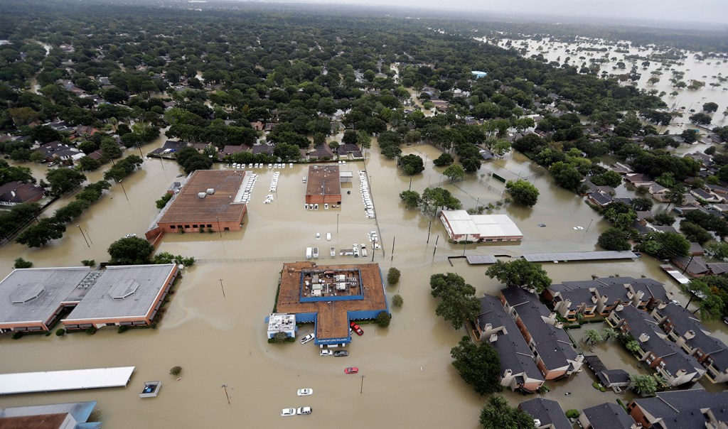 Water from Addicks Reservoir flows into neighborhoods as floodwaters from Harvey rise on Aug. 29 in Houston.