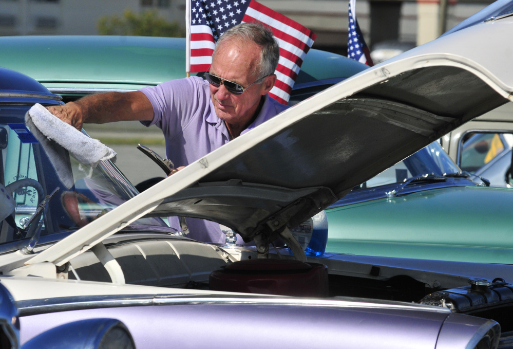 John Kirby, of New Gloucester, polishes the windshield on his 1955 Ford Fairlane on Saturday during a Hurricane Harvey fundraising car show at the Augusta Civic Center.