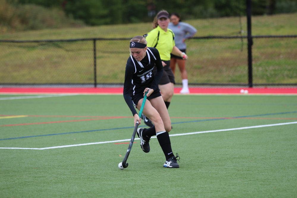 Thomas back and MCI graduate Katherine Welch moves the ball during a Sept. 3 game against Simmons.