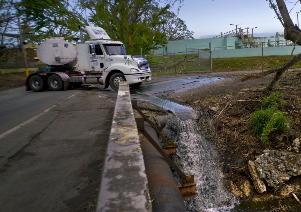 A tanker transports wastewater Thursday from a sewage plant that was left nonoperational after Hurricane Maria to a treatment plant that is working, in Dorado, Puerto Rico.