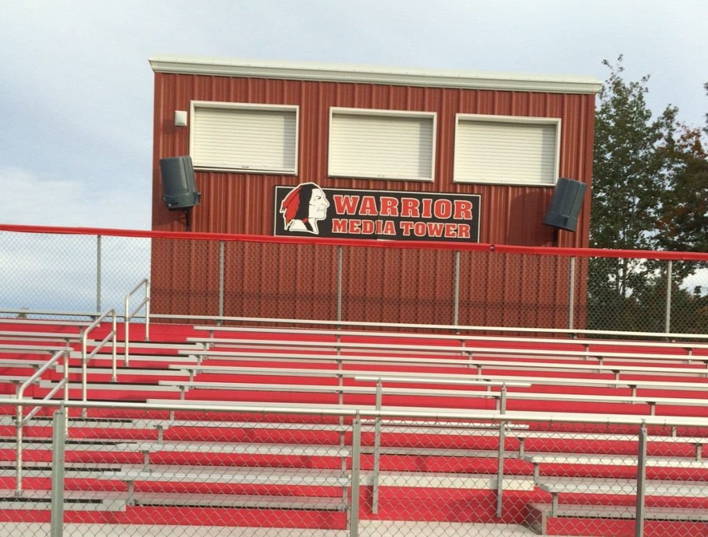 Wells High's mascot is Warriors, and the press box at Memorial Field, where the football team plays its games, features a logo of a Native American wearing feathers.