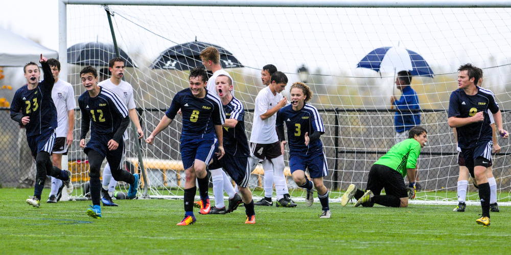 Traip celebrates the tying goal against Monmouth during a Class C South quarterfinal game Thursday at Kents Hill School.