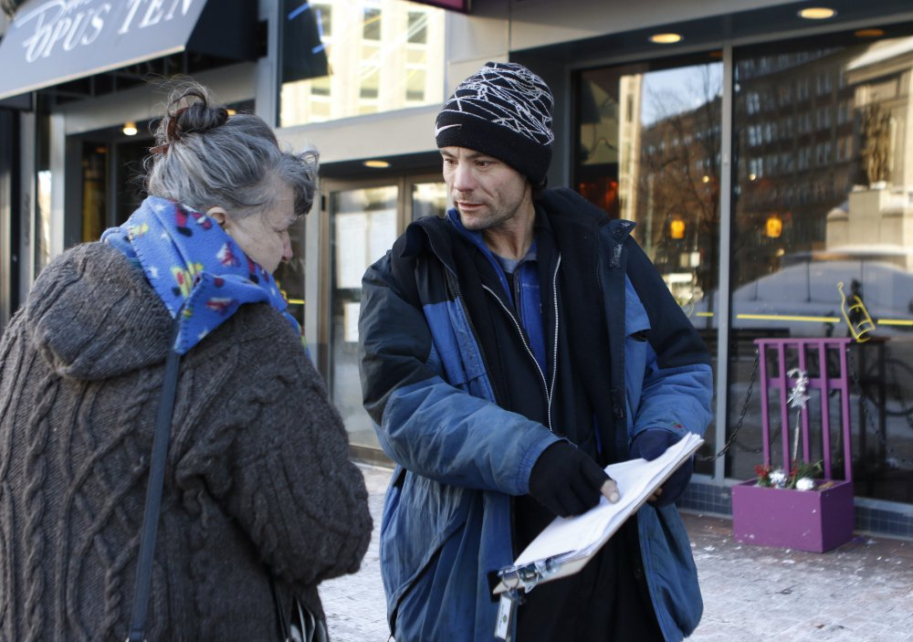 Brandon Scott speaks with Joyce Lorraine on Jan. 21, 2016, while collecting signatures on the York County casino referendum in Portland. The ethics of the casino campaign have been questioned ever since its inception with the petition drive.