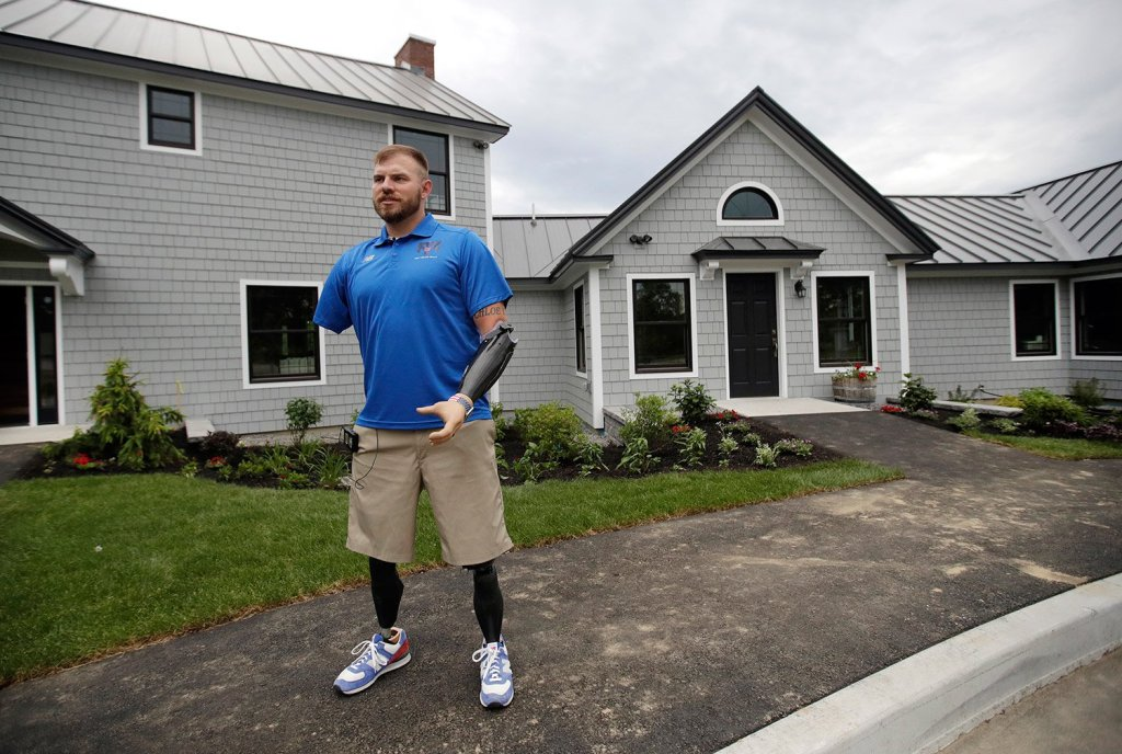 Travis Mills gives a tour of his camp for wounded veterans on June 15. The retreat will host a total of 88 veterans and their families in its first year.
