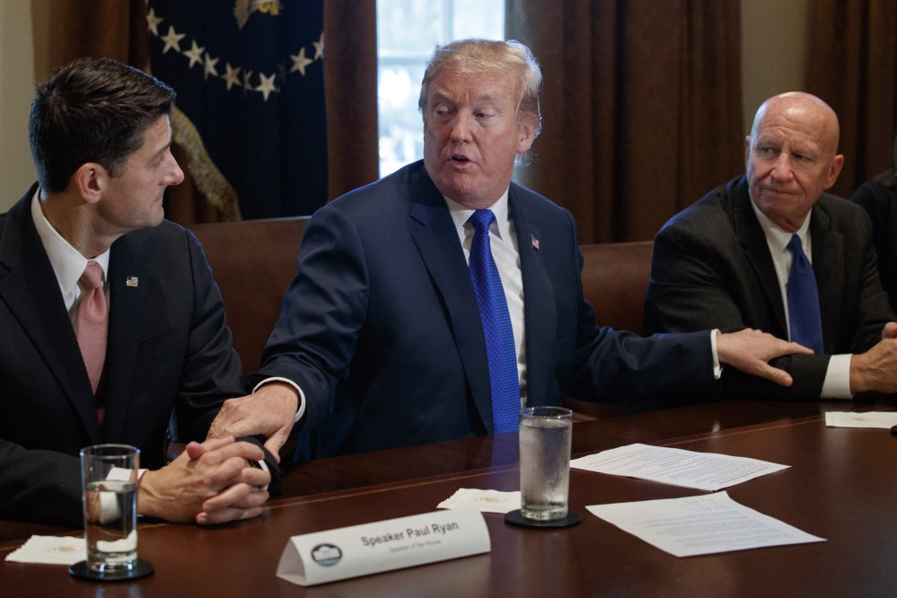 President Trump speaks during a meeting on tax policy with Republican lawmakers in the Cabinet Room of the White House on Thursday in Washington, with House Speaker Paul Ryan of Wisconsin, left, and Chairman of the House Ways and Means Committee Rep. Kevin Brady, R-Texas.