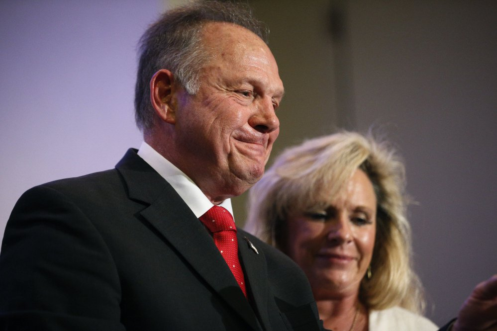 U.S. Senate candidate Roy Moore speaks at a news conference Thursday in Birmingham, Ala., with his wife, Kayla Moore.