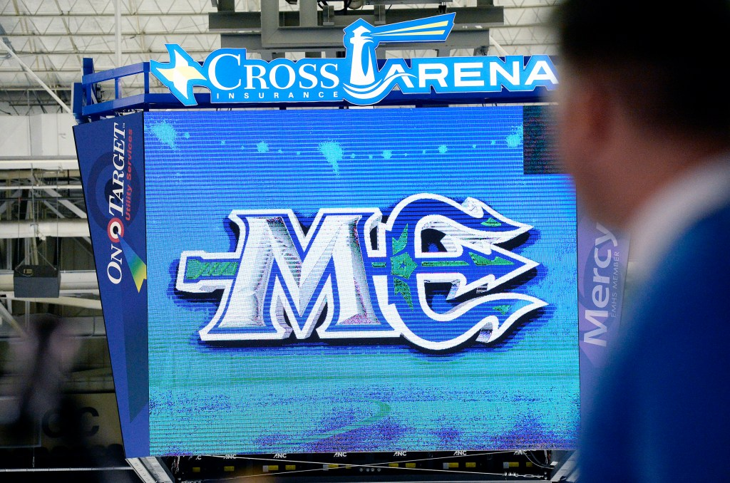 The Maine Mariners reveal their new logo Wednesday on the scoreboard at the Cross Insurance Arena in Portland. The logo's  horizontal trident forms the vowel in the abbreviation for Maine.
