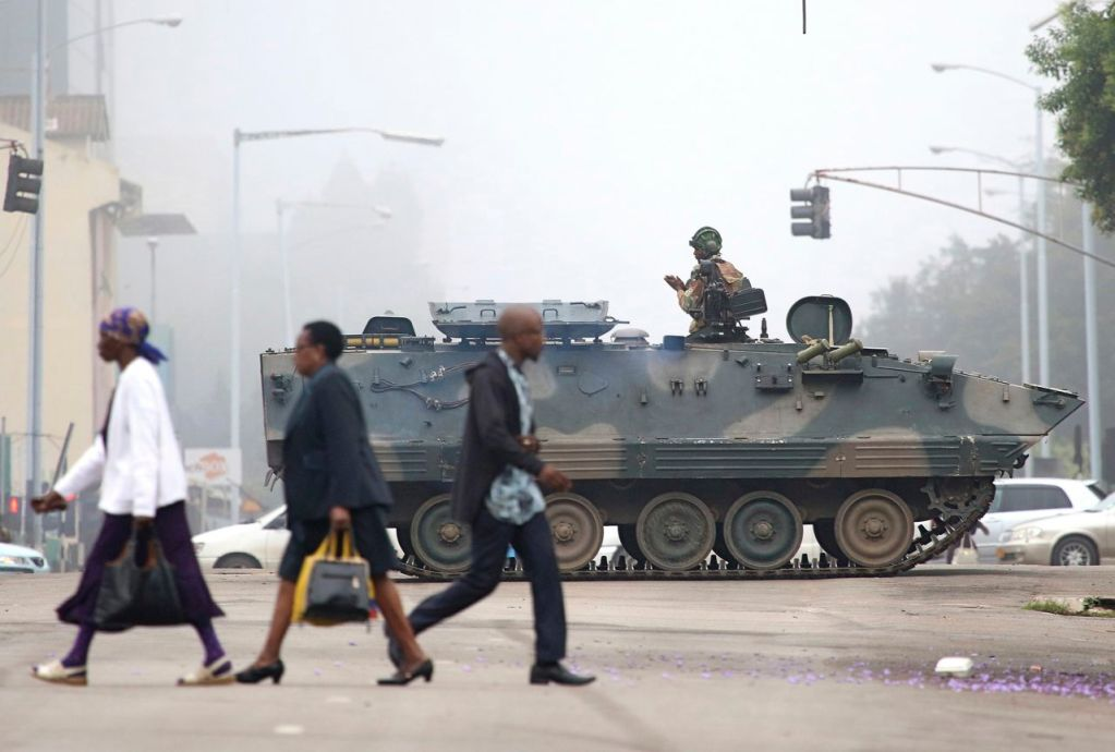 A Zimbabwe army tank blocks an intersection  in Harare, Wednesday. In the wake of a military takeover in Zimbabwe, the national police force has recalled all officers on leave.