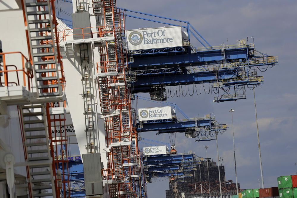 A line of cranes wait to unload ships at the Port of Baltimore. The Commerce Department reported that the U.S. trade deficit rose to $48.7 billion in October because of record imports.